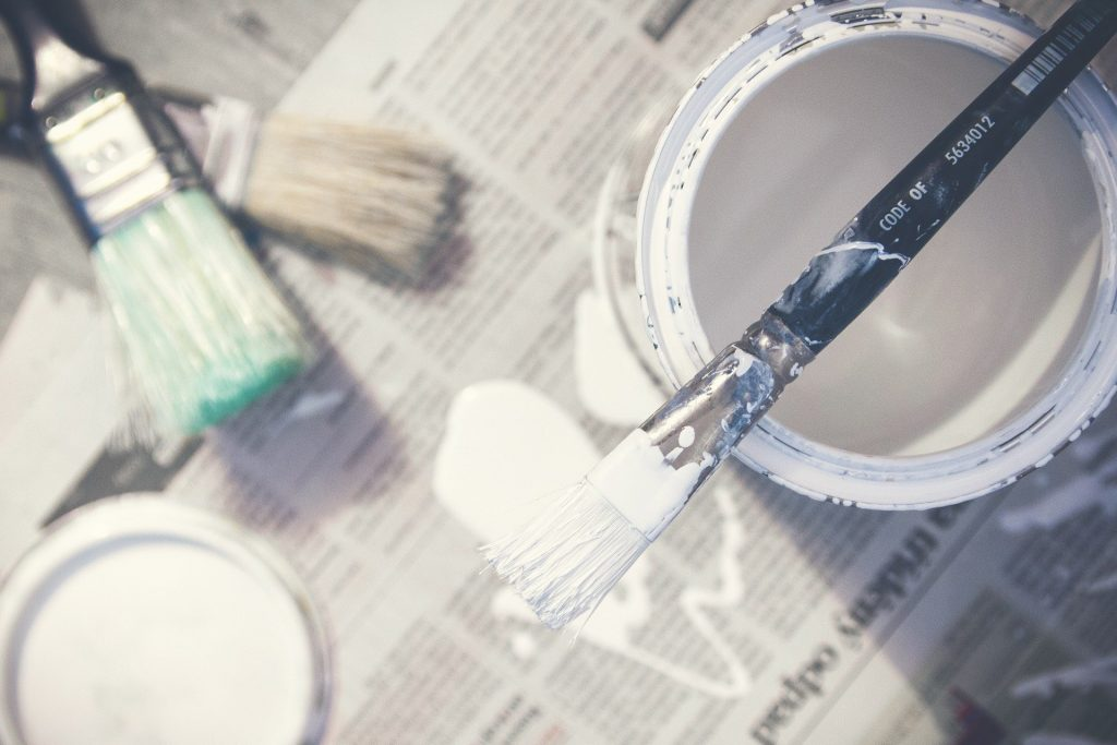 Paint tin and brushes